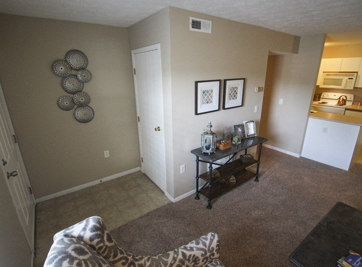 This is a photo of the living room of the 890 square foot 2 bedroom Liberty at Washington Place Apartments in Centerville, OH.