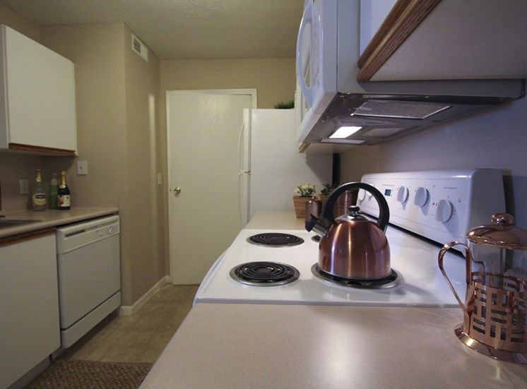 This is a photo of the kitchen of the 890 square foot 2 bedroom Liberty at Washington Place Apartments in Centerville, OH.