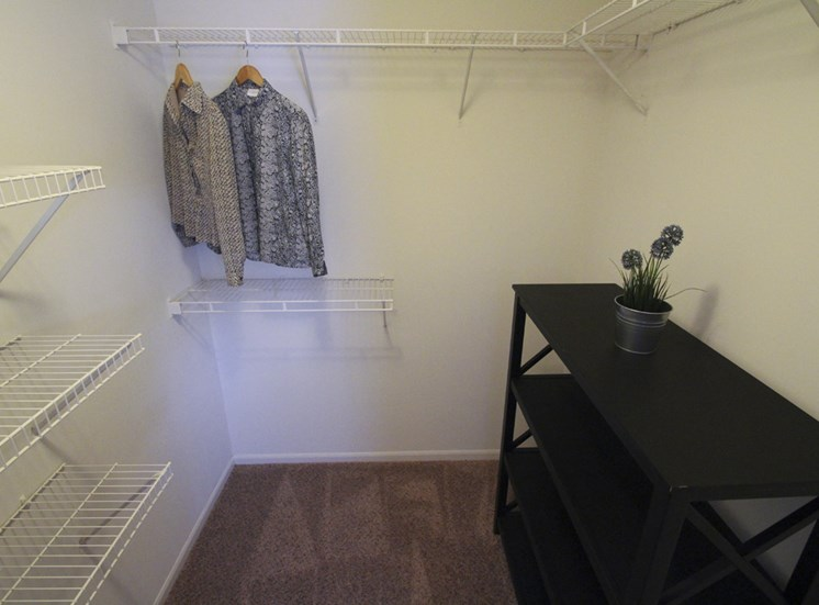 This is a photo of the walk-in closet in the master bedroom of the 890 square foot 2 bedroom Liberty at Washington Place Apartments in Centerville, OH.