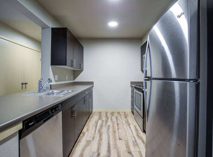 Fully Equipped Kitchen with Refrigerator, Microwave, and dishwasher