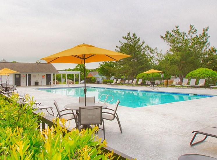 Pool  and chairs at Crosstimbers Apartments in Morrisville NC