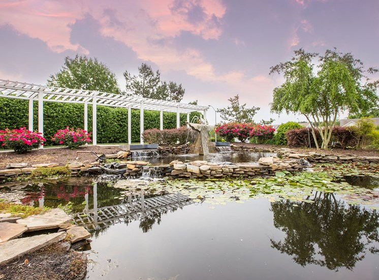 Pond with trellis at Crosstimbers apartments