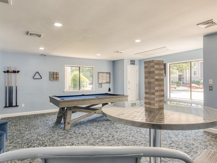 Game room at Compass at City Center Apartments