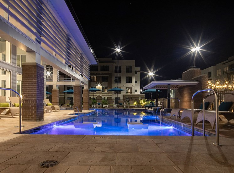 Pool at night at Lumen Apartments