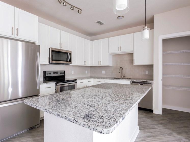 Modern kitchen with large island,at Estero Parc, Estero, FL, 33928