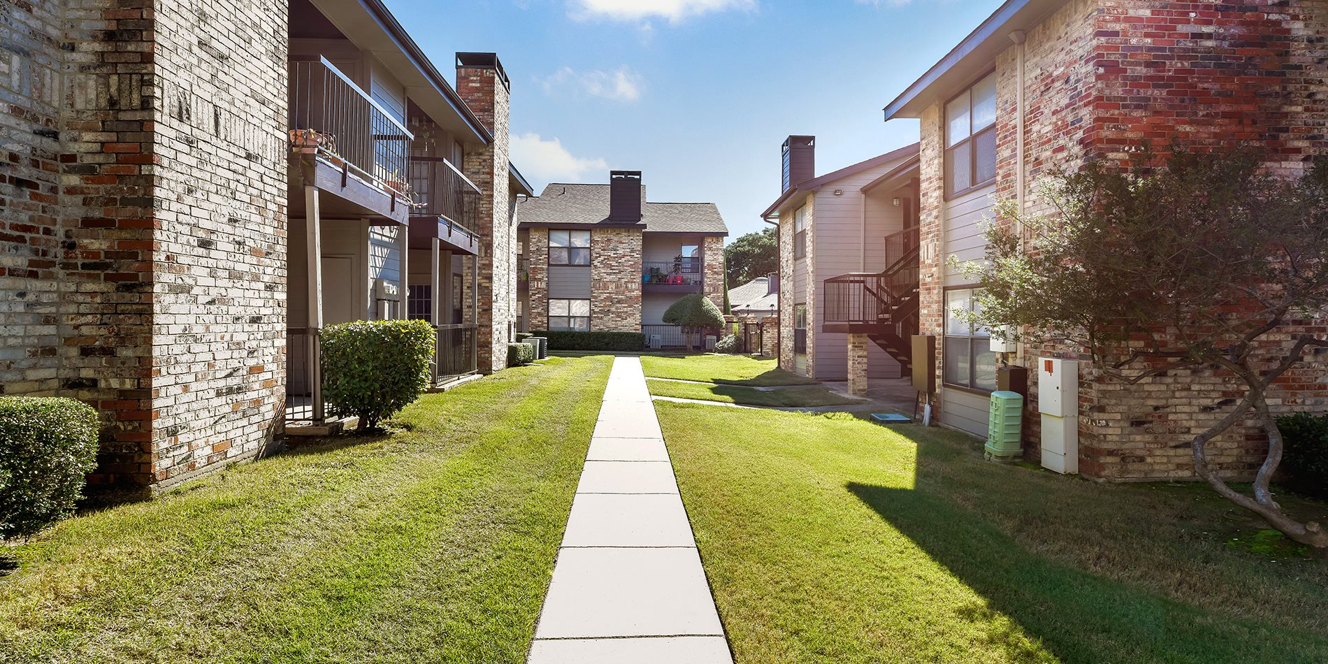 Walkway at Brighton Place Apartment Homes in Lewisville, Texas, TX