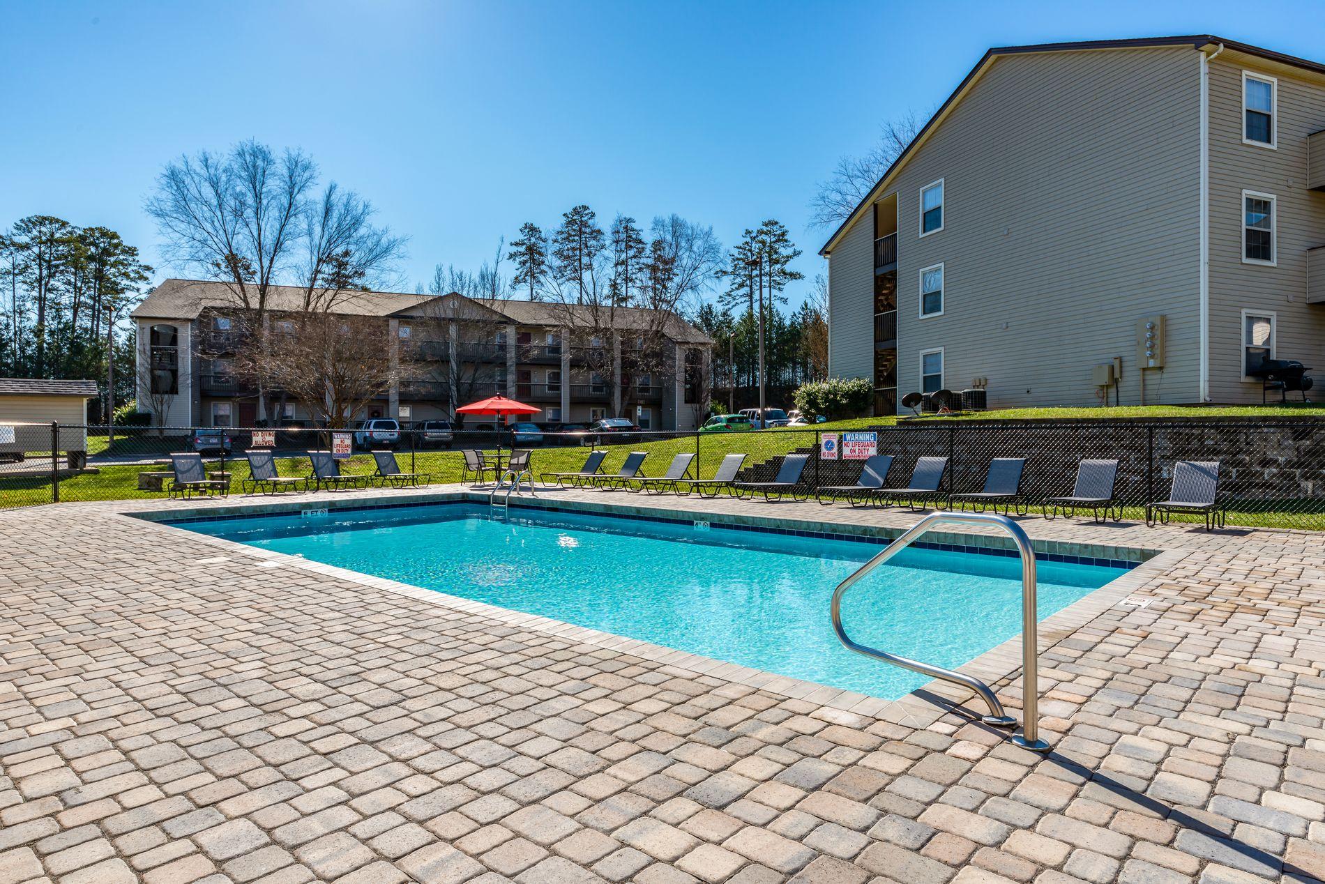Pool area at Kannan Station Apartment Homes in Kannapolis, North Carolina, NC