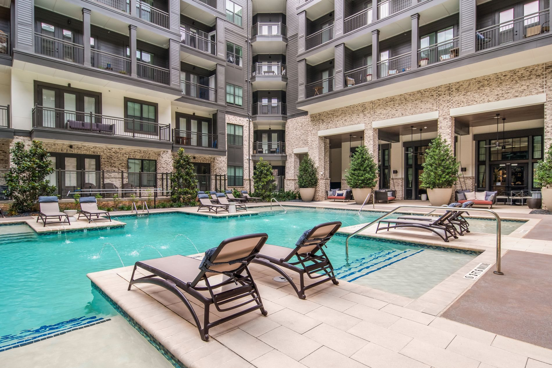 Poolside Seating at The Alastair at Aria Village Apartment Homes in Sandy Springs, Georgia, GA