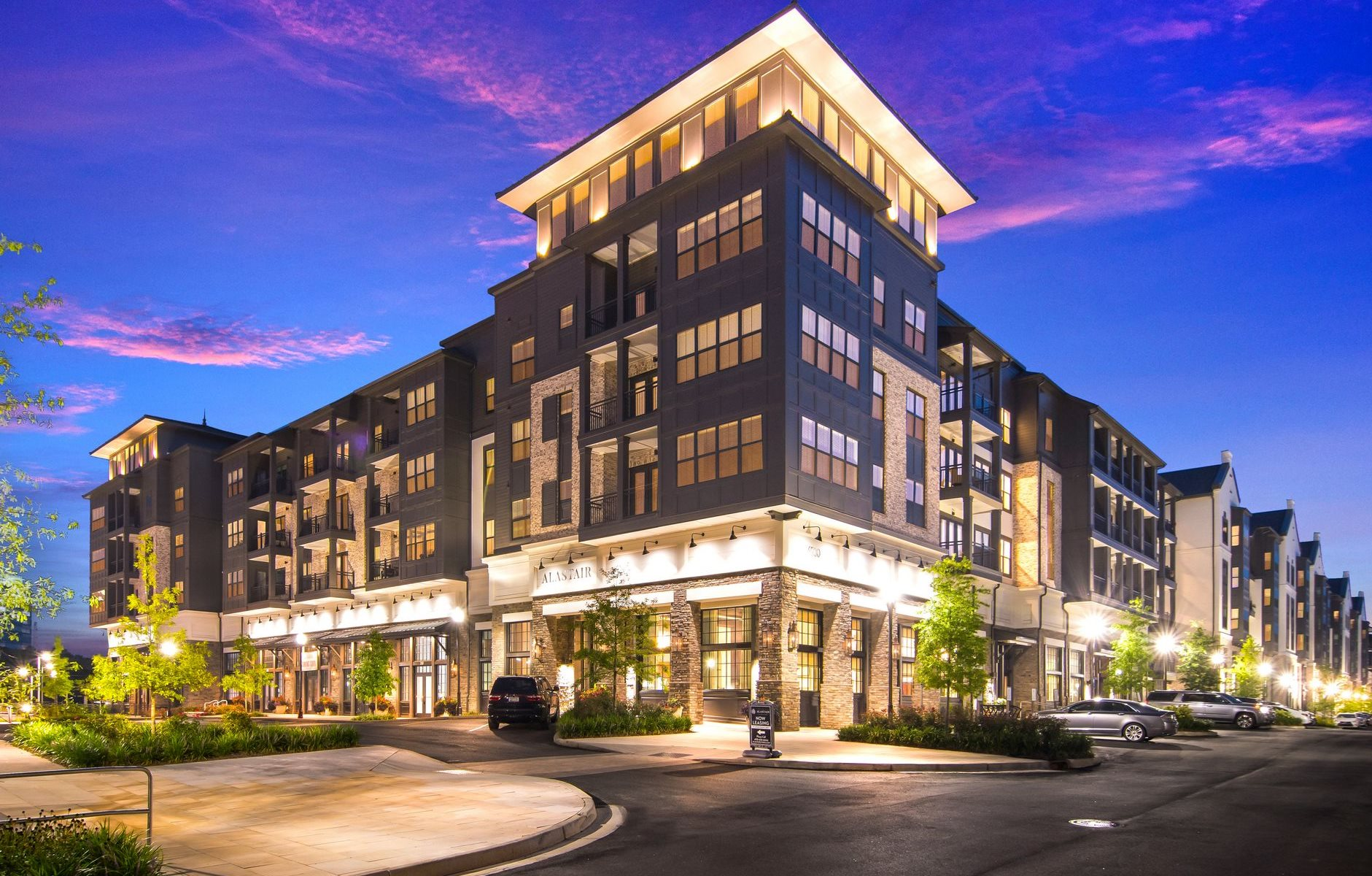 Leasing Office Exterior at Night at The Alastair at Aria Village Apartment Homes in Sandy Springs, Georgia, GA
