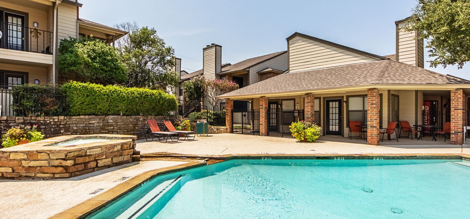 Swimming Pool at Woodmeade Apartments in Irving, Texas, TX