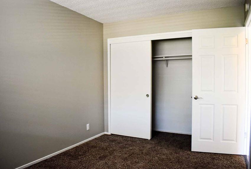 small bedroom with sliding door closet