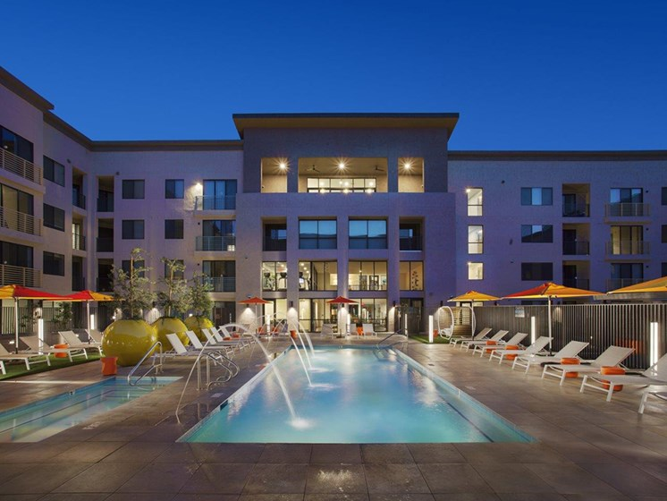 Heated pool with water features and spa at The Curve at Melrose Luxury Apartments, Phoenix, AZ, 85013