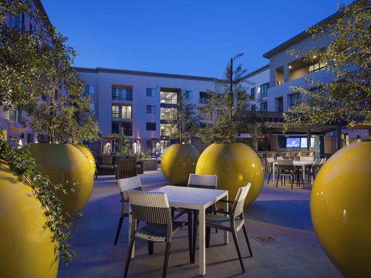 Outdoor entertainment area at The Curve at Melrose Luxury Apartments, Phoenix, AZ