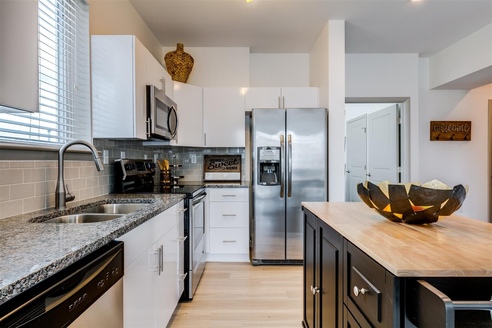Modern kitchen with stainless steel appliances and island