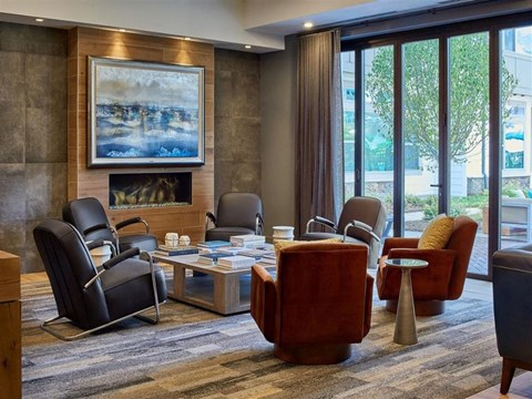 Posh Berewick Pointe Lounge Area With Fireplace In Clubhouse in North Carolina Apartment Rentals
