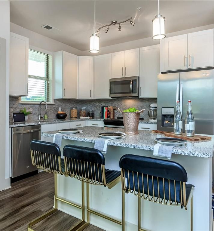 European-Style Kitchen With Breakfast Bar at Berewick Pointe, North Carolina