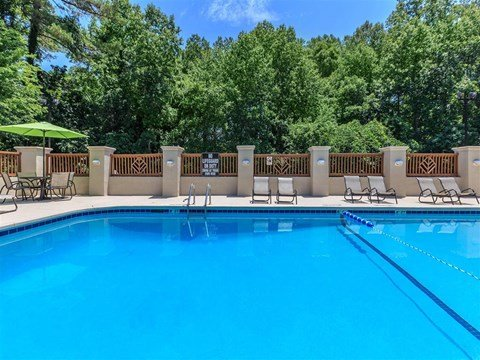 Pool With Sunning Deck at Edwards Mill Townhomes & Apartments, Raleigh