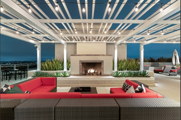 Westwood Luxury-Apartments-Wilshire-Victoria--Rooftop-Resident-Lounge-Couch-Fireplace-evening-dusk4