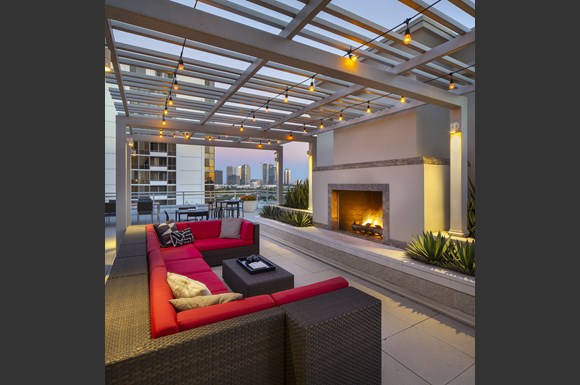 Westwood Luxury-Apartments-Wilshire-Victoria--Rooftop-Resident-Lounge-Couch-Fireplace-evening-dusk2