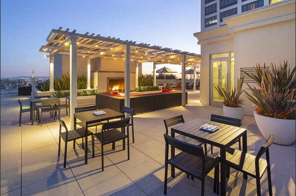 Westwood Luxury-Apartments-Wilshire-Victoria--Rooftop-Resident-Lounge-Couch-Fireplace-evening-dusk3