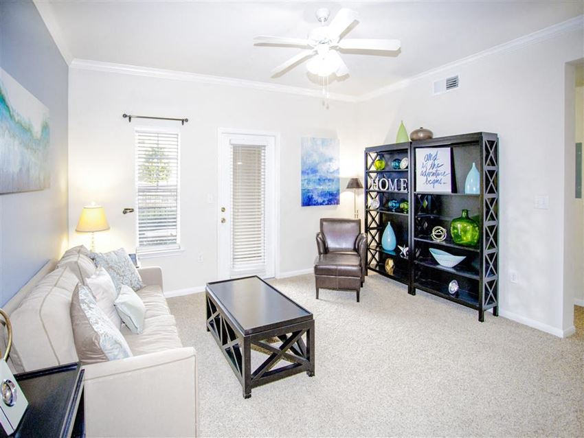 Spacious living room ceiling fan 1, 2, and 3 bedroom apartments for rent Estancia