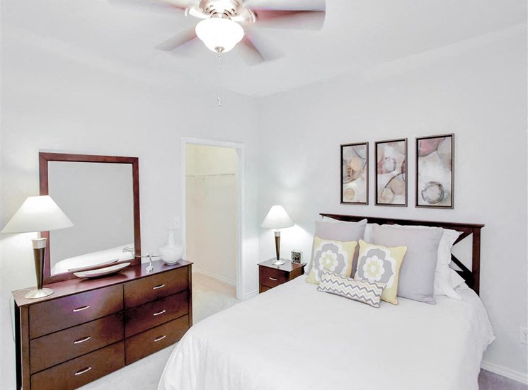 Walk in closet through bedroom at The Remington at Memorial in Tulsa, OK, For Rent. Now leasing 1 and 2 bedroom apartments.