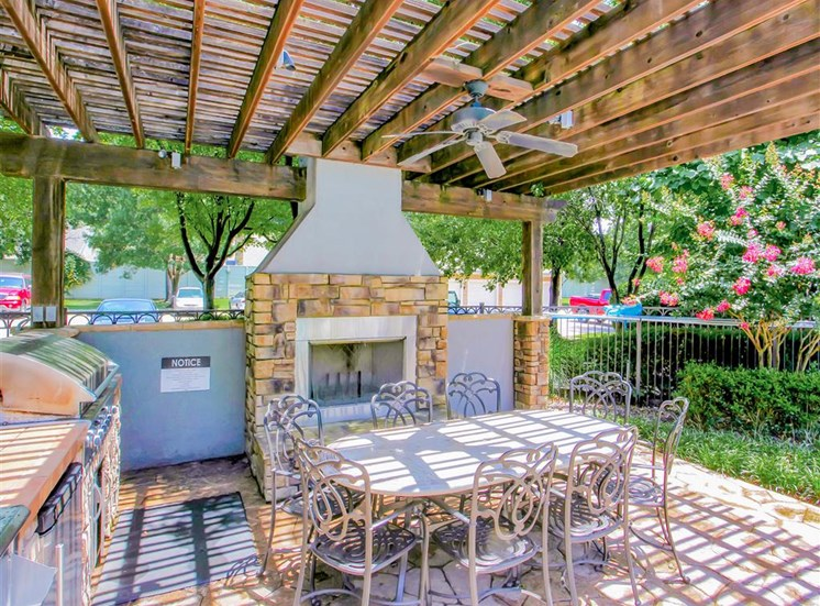 Outdoor fireplace and BBQ Grills at The Remington at Memorial in Tulsa, OK, For Rent. Now leasing 1 and 2 bedroom apartments.