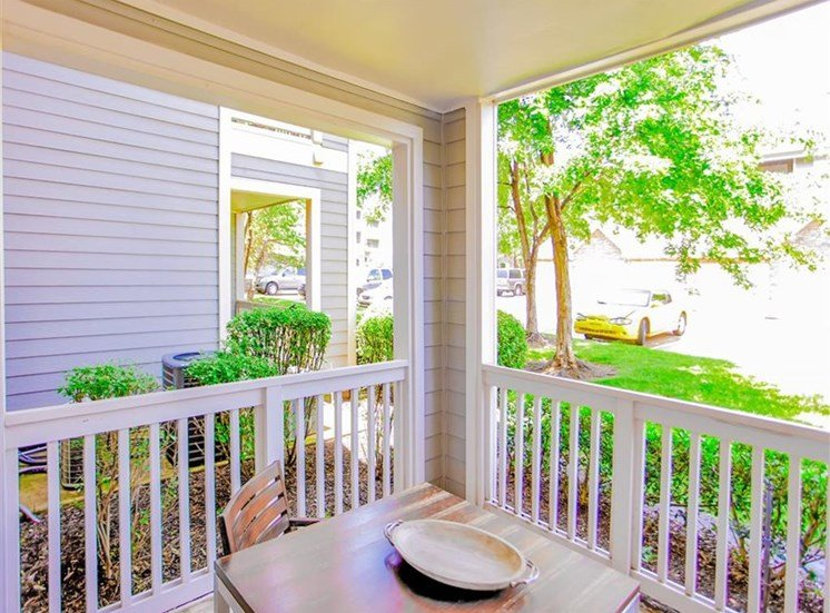 Outdoor dining in private patio at The Remington at Memorial in Tulsa, OK, For Rent. Now leasing 1 and 2 bedroom apartments.