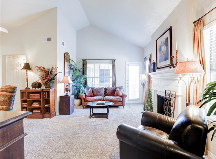 Vaulted ceiling, fireplace and balcony of Saddle Brook Apartments in North Dallas, TX, For Rent. Now Leasing 1, 2 and 3 bedroom apartments.