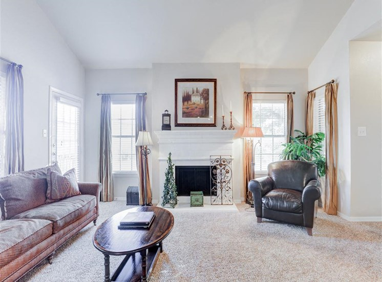 Fireplace in living room at Saddle Brook Apartments in North Dallas, TX, For Rent. Now Leasing 1, 2 and 3 bedroom apartments.