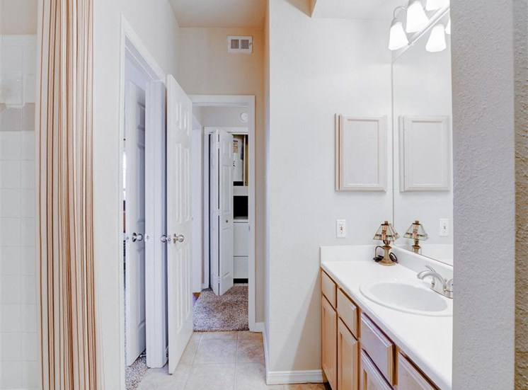 Spacious walk through bathroom at Saddle Brook Apartments in North Dallas, TX, For Rent. Now Leasing 1, 2 and 3  bedroom apartments.