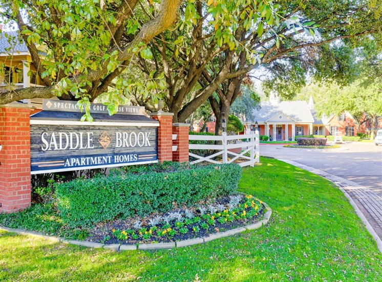 Gated community entrance Saddle Brook Apartments in North Dallas, TX, For Rent. Now Leasing 1, 2 and 3 bedroom apartments.