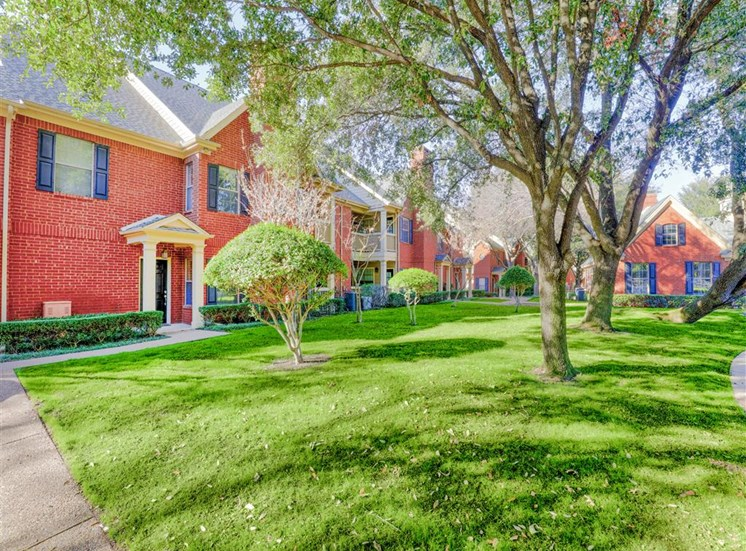 Mature trees of Saddle Brook Apartments in North Dallas, TX, For Rent. Now Leasing 1, 2 and 3 bedroom apartments.