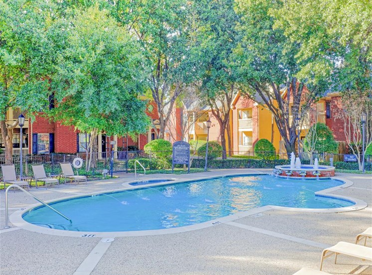 Resort style pool of Saddle Brook Apartments in North Dallas, TX, For Rent. Now Leasing 1, 2 and 3 bedroom apartments.