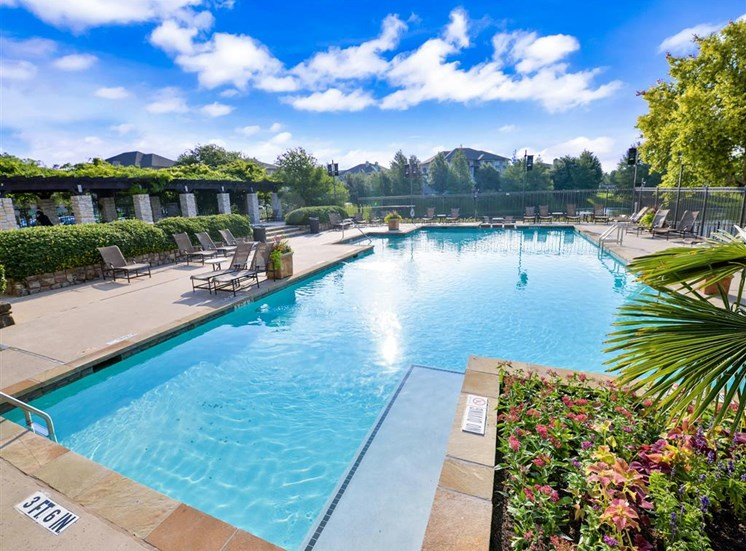 Resort pool of Cypress Lake at Stonebriar Apartments in Frisco, TX, For Rent. Now leasing 1, 2 and 3 bedroom apartments.