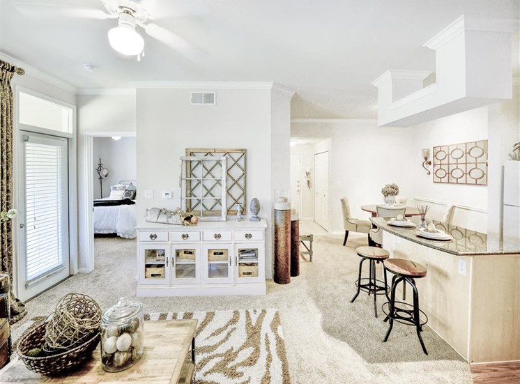 Dine at kitchen island of Cypress Lake at Stonebriar Apartments in Frisco, TX, For Rent. Now leasing 1, 2 and 3 bedroom apartments.