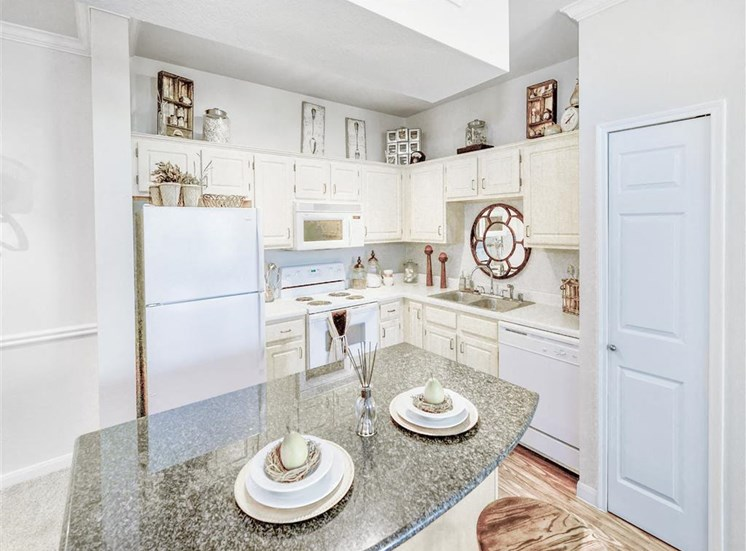 Granite island and dishwasher at Cypress Lake, Now Renting in Frisco, TX - 1, 2, and 3 bedroom apartments