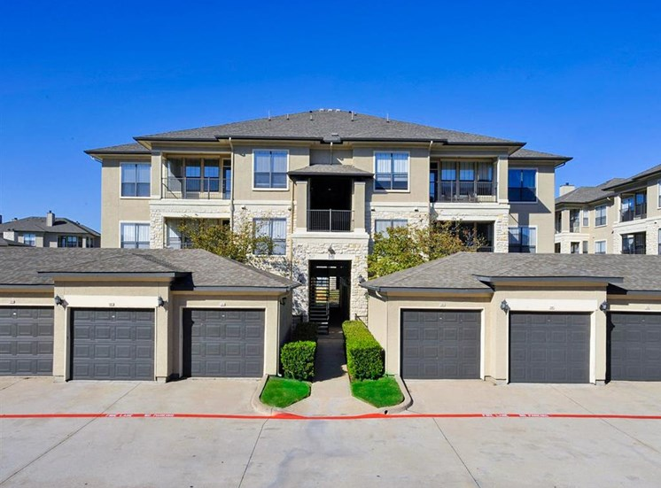 Covered garages of Cypress Lake at Stonebriar Apartments in Frisco, TX, For Rent. Now leasing 1, 2 and 3 bedroom apartments.