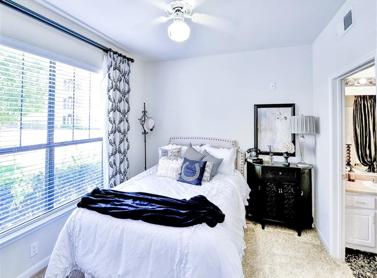 Ceiling fan in bedroom of Cypress Lake at Stonebriar Apartments in Frisco, TX, For Rent. Now leasing 1, 2 and 3 bedroom apartments.