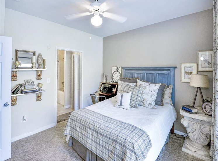 Ceiling fan in bedroom with en suite at Cypress Lake at Stonebriar Apartments in Frisco, TX, For Rent. Now leasing 1, 2 and 3 bedroom apartments.
