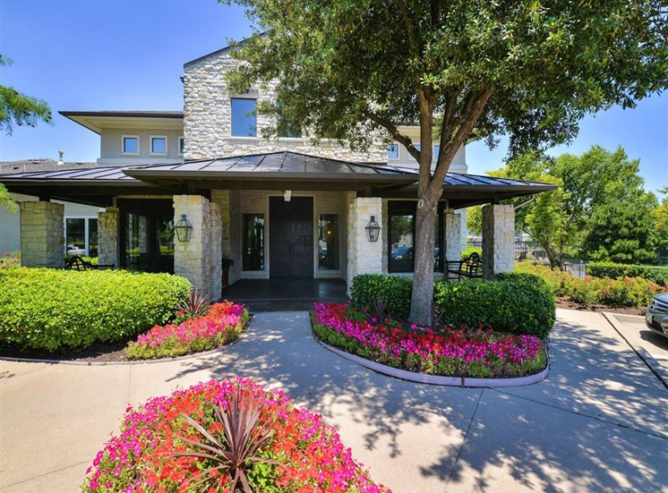 Front landscaping of Cypress Lake at Stonebriar Apartments in Frisco, TX.