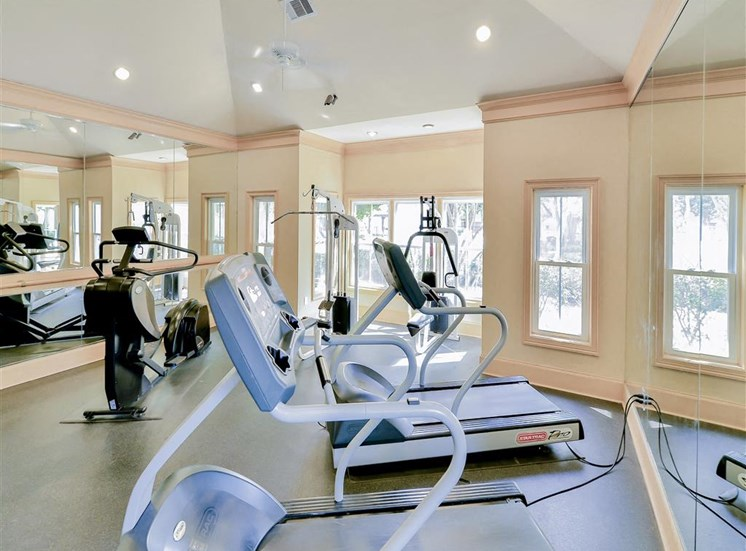 Cardio and weight training in fitness center at Saxony at Chase Oaks in North Plano, TX, For Rent. Now leasing 1, 2 and 3 bedroom apartments.