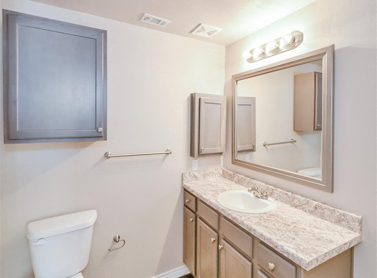 Mirrored vanity of Saxony at Chase Oaks in North Plano, TX, For Rent. Now leasing 1, 2 and 3 bedroom apartments.