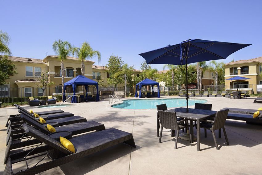 Swimming Pool with Lounge Chairs at Santa Rosa Apartment Homes, California