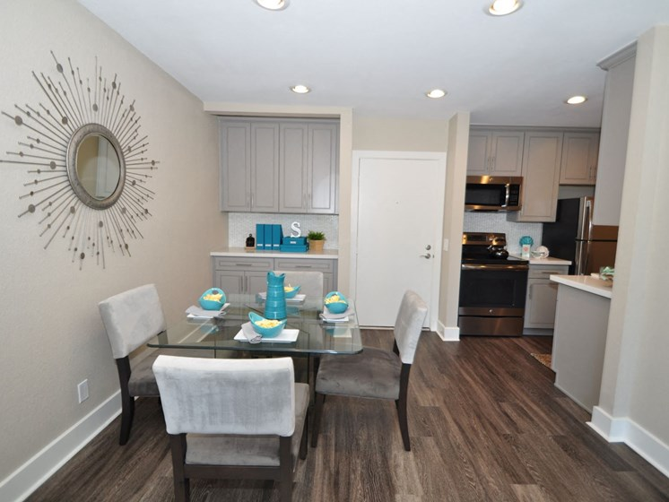 Dining Area and Open Kitchen  at Stonewood Gardens Apartment Homes, 3889 Midway Drive