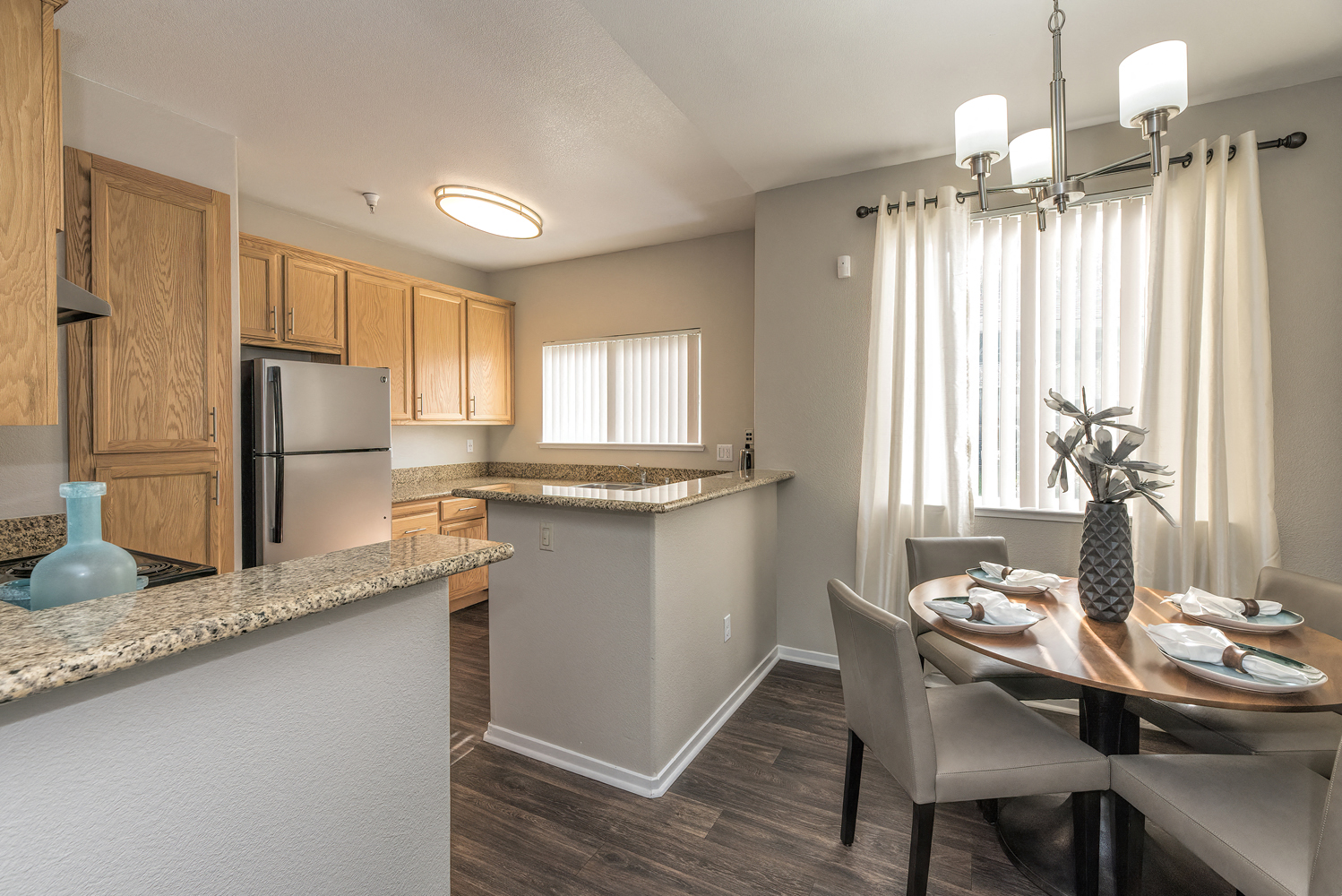 Dining Room and Kitchen View at Atwood Apartments, California, 95610