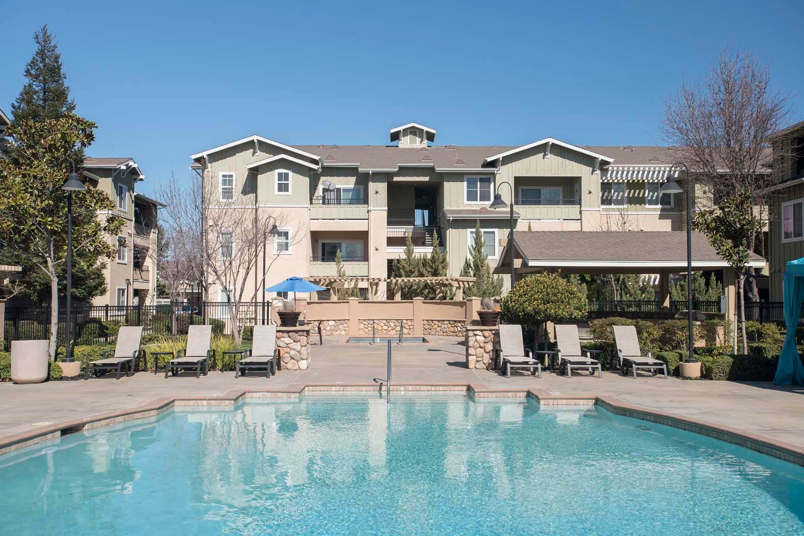 Pool With Sunning Deck at Waterstone Apartment Homes, Tracy, CA