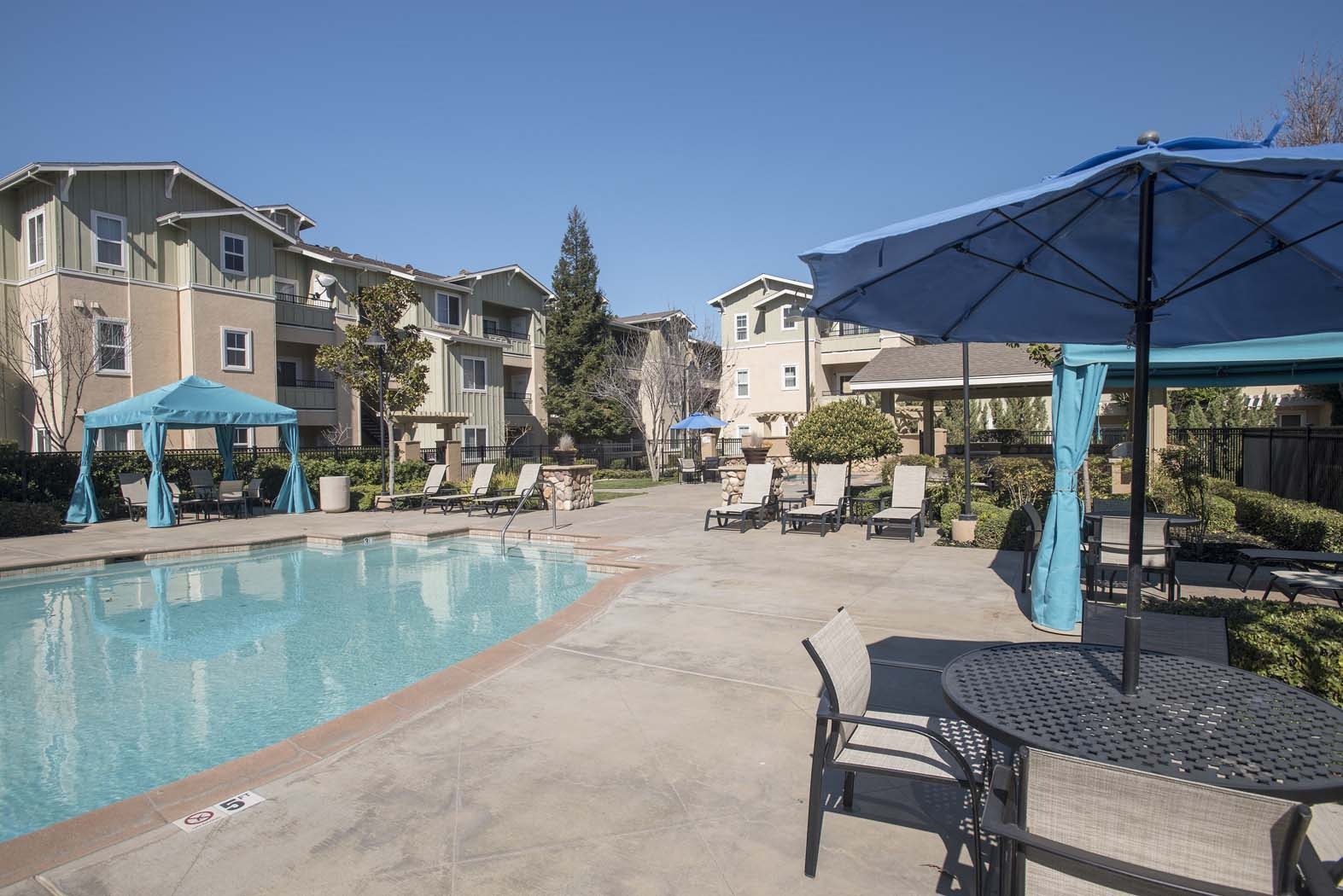 Relaxing Pool Area With Sundeck at Waterstone Apartment Homes, Tracy, California