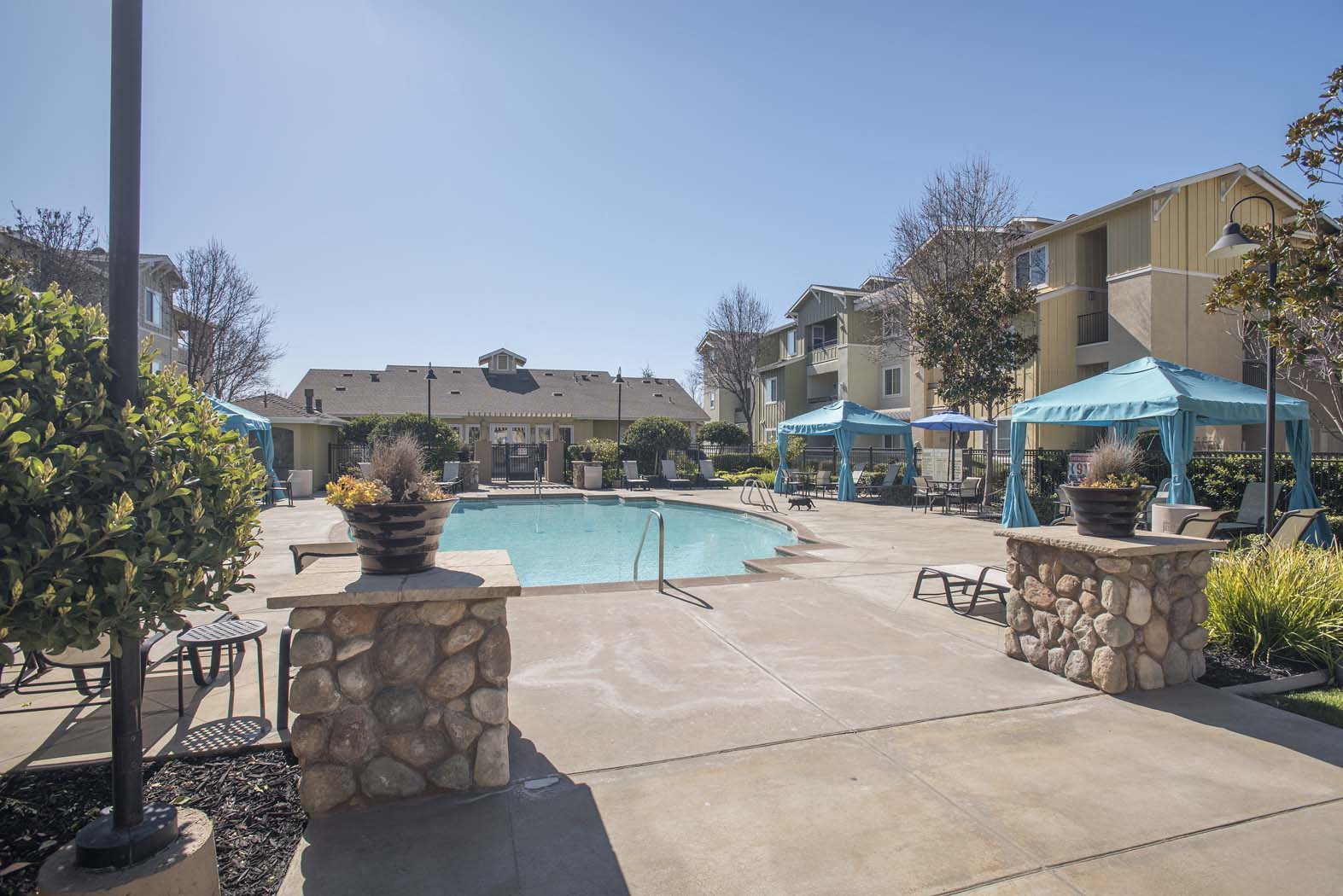 Pool with Cabana and Chairs at Waterstone Apartment Homes, California, 95377