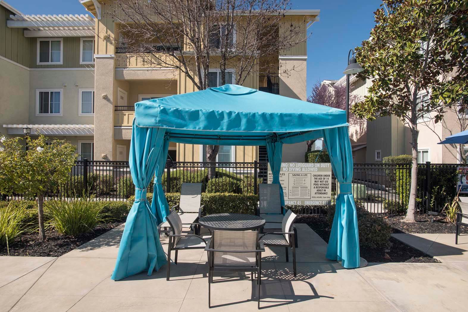 Shaded Lounge Area By Pool at Waterstone Apartment Homes, Tracy, CA